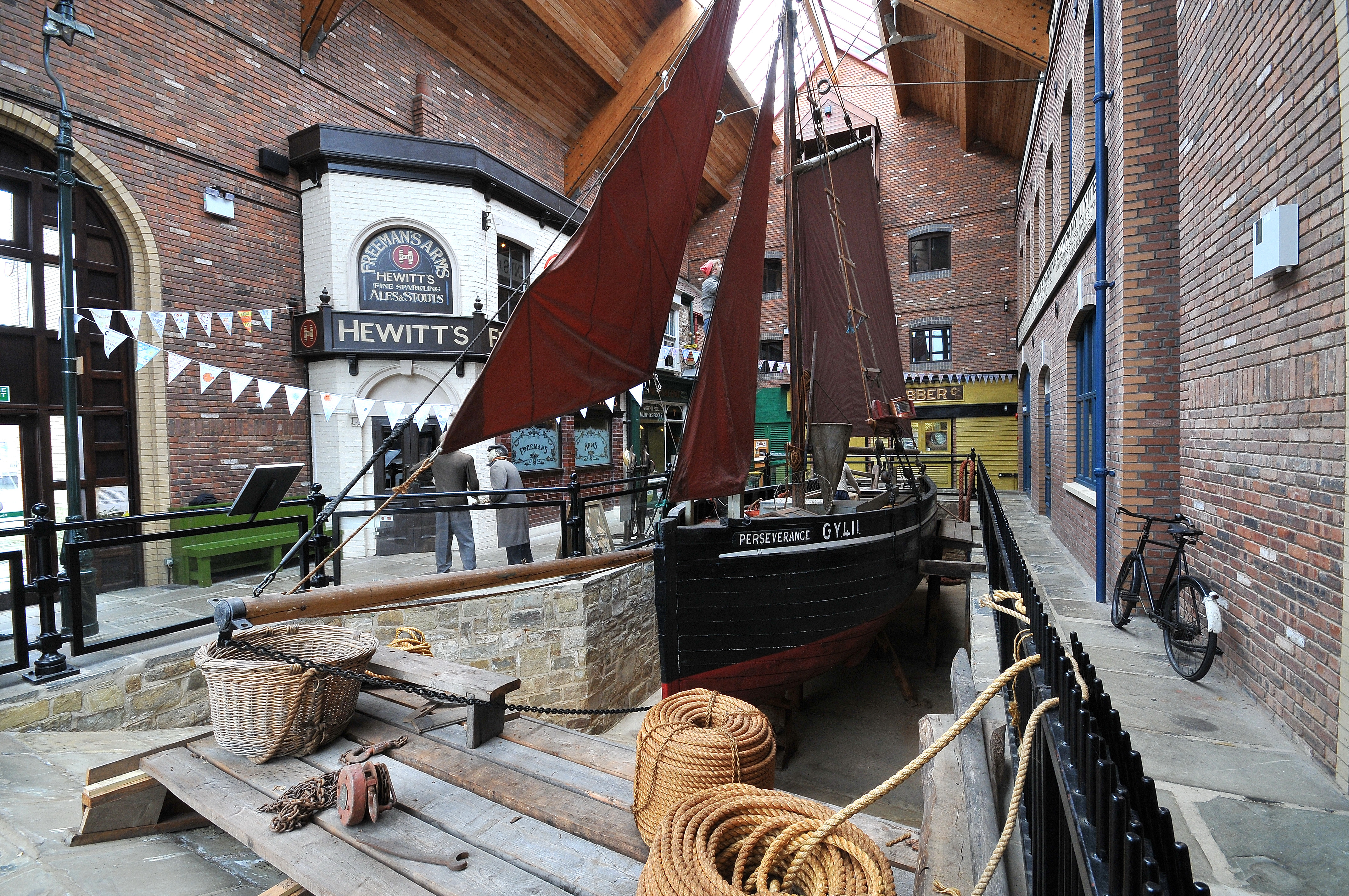 View a recreation of the street of Grimsby during the fishing hayday along with the perseverance boat.